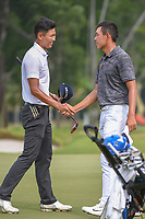 Jin-Bo HA (KOR) shakes hands with Cheng JIN (CHN) following Rd 3 of the Asia-Pacific Amateur Championship, Sentosa Golf Club, Singapore. 10/6/2018.<br /> Picture: Golffile | Ken Murray<br /> <br /> <br /> All photo usage must carry mandatory copyright credit (© Golffile | Ken Murray)