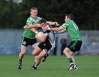 5th October 2013; Dathai MacSamhrain, St Peregrines, is tackled by Brian O Coloin (left) and Breandan O'Gallchoir, Lucan Sarsfields. Dublin Senior Football Championship, St Peregrines v Lucan Sarsfields, Blakestown, Dublin. Picture credit: Tommy Grealy / Actionshots.ie