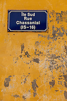 Senegal, Saint Louis.  Street Sign on Old Building Wall.