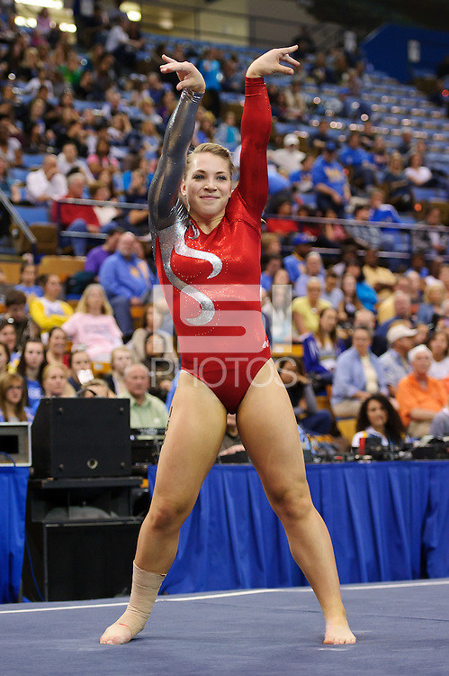LOS ANGELES, CA - March 19, 2011:  Stanford's Nicole Dayton competes in floor exercise during the Pac-10 Championship at UCLA's Pauley Pavilon.   Stanford placed fourth in the competition.