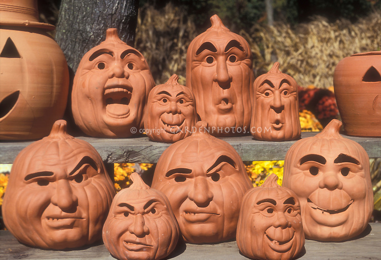 Halloween Pumpkin Decorations - variety of clay terra cotta pottery Jack O'Lantern faces and heads in autumn. PLEASE NOTE THAT WE SELL IMAGES OF THESE ONLY. WE DO NOT SELL THESE OBJECTS.