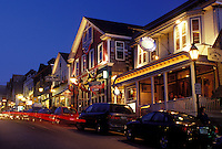 Bar Harbor, ME, Maine, Mount Desert Island, Seafood restaurants along the street in downtown Bar Harbor in the evening.