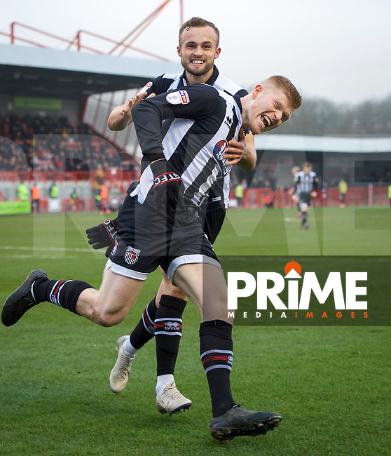 Elliott Whitehouse of Grimsby Town celebrates after scoring the equaliser with Charles Vernam of Grimsby Town during the Sky Bet League 2 match between Crawley Town and Grimsby Town at The People's Pension Stadium, Crawley, England on 25 January 2020. Photo by Alan  Stanford / PRiME Media Images.