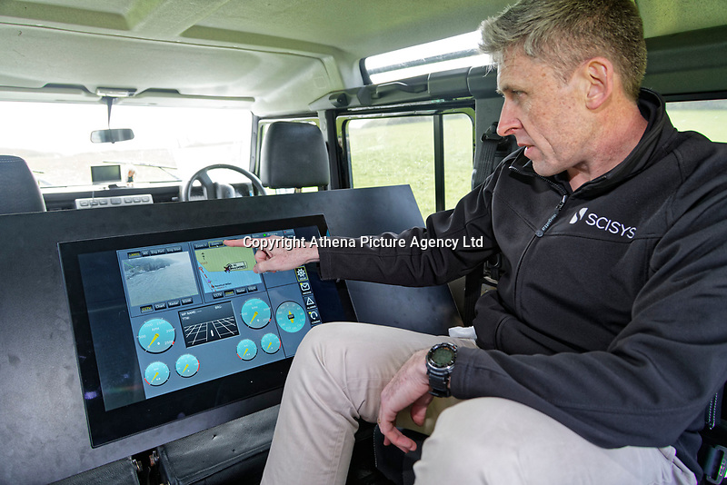 Pictured: Chris Burton of SCISYS operating the system used for the exercise. Friday 20 April 2018 <br /> Re: The Royal National Lifeboat Institution (RNLI) and the Maritime and Coastguard Agency (MCA) have held a special media event to demonstrate how drones could be used in search and rescue activity in the future to help save lives at the Atlantic College in St Donats, south Wales, UK. <br /> The rescue scenario took place along a stretch of coastline in south Wales, featuring a drone, an RNLI lifeboat and an MCA helicopter winching the casualty to safety.