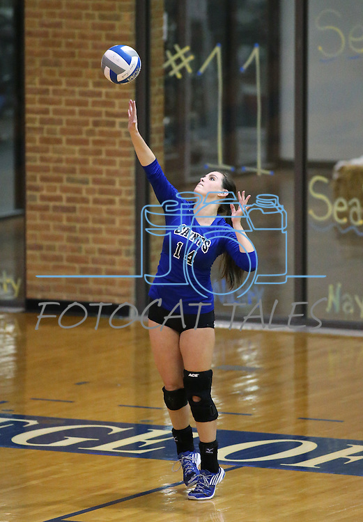 Marymount's Erin Allison serves in a college volleyball game against St. Mary's in Lexington Park, MD, on Wednesday, Oct. 29, 2014. Marymount won 3-2 to go 24-9 on the season.<br /> Photo by Cathleen Allison