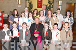 Pupils from Sliabh A'Mhadra National School, Ballyduff, who were confirmed on Thursday by Bishop Bill Murphy in St Peter & Pauls Church. Front row l-r: John O'Regan, Andrew Dineen, Michael O'Sullivan, David Goulding, Darragh O'Sullivan and Danny O'Shea. Middle row l-r: Katie Fletcher, Louise McGrath, Nicole O'Grady, Cora Enright, Jessica O'Carroll, Niamh White and Kelly O'Sullivan. Back row l-r: Patrick Condon, Laura O'Rourke, Jim McEllistrim (Principal) and James O'Sullivan..