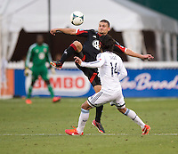 Perry Kitchen (23) of D.C. United fights for the ball with Daigo Kobayashi (14) of the Vancouver Whitecaps during a Major League Soccer match at RFK Stadium in Washington, DC. D.C. United lost to the Vancouver Whitecaps, 1-0.