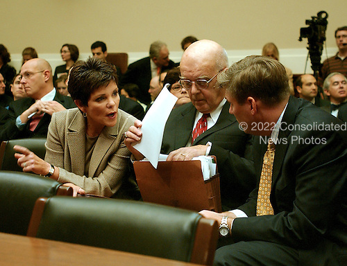 """Washington, D.C. - September 28, 2006 -- Patricia Dunn, former Chairman of the Board, Hewlett-Packard Company, left, speaks with her attorneys Jim Bresnahan, center, and Drew Maloney, right, prior to testifying before the United States House Subcommittee on Oversight and Investigations hearing on """" Hewlett-Packard's Pretexting Scandal"""" in Washington, D.C. on September 28, 2006..Credit: Ron Sachs / CNP.[No New York Metro or other Newspapers within a 75 mile radius of New York City]"""