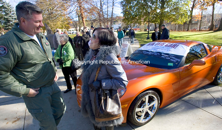 TORRINGTON, CT. 11 November 2010-111110SV03--From left, Charles Loya of Torrington meets Anne MacDonald-Borghesi of Torrington during the Veterans Day ceremonies in Torrington Thursday. Loya returned from Iraq in July and was with a group from Westover Ma. Borghesi donated the car that was raffled off to raise money for Veterans Memorial Wall.<br /> Steven Valenti Republican-American
