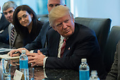 United States President-elect Donald Trump is seen at a meeting of technology leaders in the Trump Organization conference room at Trump Tower in New York, NY, USA on December 14, 2016. <br /> Credit: Albin Lohr-Jones / Pool via CNP