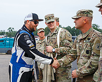 Aug 20, 2017; Brainerd, MN, USA; NHRA top fuel driver Shawn Langdon greets US Army soldiers during the Lucas Oil Nationals at Brainerd International Raceway. Mandatory Credit: Mark J. Rebilas-USA TODAY Sports