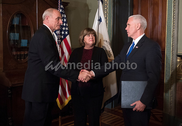 Retired Marine General James Kelly shakes hands with Vice President Mike Pence after being sworn-in as Secretary of Homeland Security, in the Vice Presidential ceremonial office in the Executive Office Building in Washington, D.C. on January 20, 2017. Photo Credit: Kevin Dietsch/CNP/AdMedia
