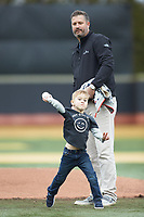 Kyle Sleeth, 2019 Wake Forest Sports Hall of Fame inductee, stands behind his son Avery as he throws out a ceremonial first pitch prior to the NCAA baseball game between the Illinois Fighting Illini and the Wake Forest Demon Deacons at David F. Couch Ballpark on February 16, 2019 in  Winston-Salem, North Carolina.  The Fighting Illini defeated the Demon Deacons 5-2. (Brian Westerholt/Four Seam Images)