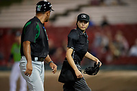Dayton Dragons manager Luis Bolivar (14) argues a call with umpire Emma Charlesworth-Seiler during a Midwest League game against the Kane County Cougars on July 20, 2019 at Northwestern Medicine Field in Geneva, Illinois.  Dayton defeated Kane County 1-0.  (Mike Janes/Four Seam Images)