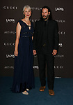 LOS ANGELES, CALIFORNIA - NOVEMBER 02: Alexandra Grant, Keanu Reeves arrive at the LACMA Art + Film Gala Presented By Gucci on November 02, 2019 in Los Angeles, California. Photo: CraSH/imageSPACE/MediaPunch