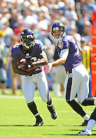 Sep. 20, 2009; San Diego, CA, USA; Baltimore Ravens running back (23) Willis McGahee takes the handoff from quarterback (5) Joe Flacco against the San Diego Chargers at Qualcomm Stadium in San Diego. Baltimore defeated San Diego 31-26. Mandatory Credit: Mark J. Rebilas-