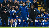 Olivier Giroud of Chelsea holds his leg after a second injury while Antonio Conte looks on during the Premier League match between Chelsea and West Bromwich Albion at Stamford Bridge, London, England on 12 February 2018. Photo by Andy Rowland.