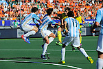 The Hague, Netherlands, June 13: During the field hockey semi-final match (Men) between Australia and Argentina on June 13, 2014 during the World Cup 2014 at Kyocera Stadium in The Hague, Netherlands. Final score 5-1 (3-0)  (Photo by Dirk Markgraf / www.265-images.com) *** Local caption *** (L-R) Manuel Brunet #24 of Argentina, Rey Lucas #8 of Argentina, Eddie Ockenden #11 of Australia, Juan Martin Lopez #17 of Argentina