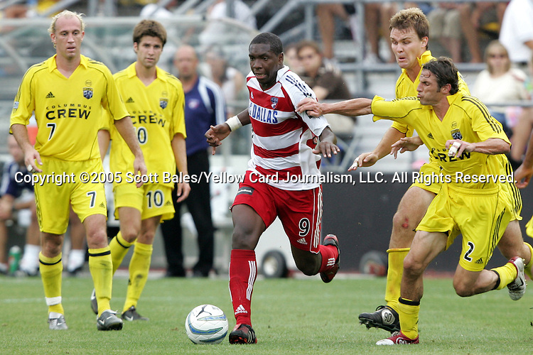 20 August 2005: Dallas's Roberto Mina (9) runs through a bevy of Columbus players.  Left to right in yellow: Simon Elliott, Kyle Martino, Chad Marshall, Frankie Hejduk. The Columbus Crew defeated FC Dallas 1-0 at Columbus Crew Stadium in Columbus, Ohio in a Major League Soccer Regular Season Match.