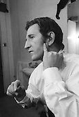 Lance Percival, comedy actor, getting changed in his dressing room at the Yvonne Arnaud Theatre, Guildford, Surrey, UK.  1968.