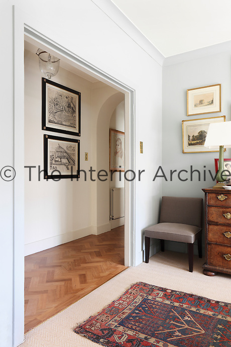 A wide doorway leads into the main corridor of the flat, which still retains its original teak parquet floors
