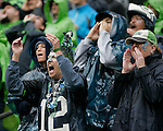 Seattle fans cheer the Seahawks  45-17 win over the Jacksonville at CenturyLink Field in Seattle, Washington on September 22, 2013.   ©2013. Jim Bryant Photo. ALL RIGHTS RESERVED.