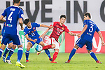 Zhang Wenzhao (c) of Guangzhou Evergrande FC fights for the ball with Tse Man Wing (l) and Moreira Diego Eli of Eastern SC (r) during their AFC Champions League 2017 Match Day 1 Group G match between Guangzhou Evergrande FC (CHN) and Eastern SC (HKG) at the Tianhe Stadium on 22 February 2017 in Guangzhou, China. Photo by Victor Fraile / Power Sport Images