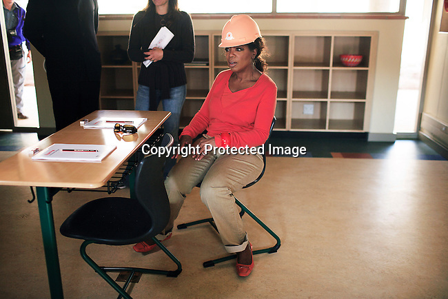 "JOHANNESBURG, SOUTH AFRICA AUGUST 10: Oprah Winfrey inspects a class room on the site of her school ""Oprah Winfrey Leadership Academy for Girls"" located about 40 miles south of Johannesburg in Henley-on-Klip, Meyerton. Oprah visited South Africa to interview girls and to inspect the construction of the school. (Photo by Per-Anders Pettersson)..."