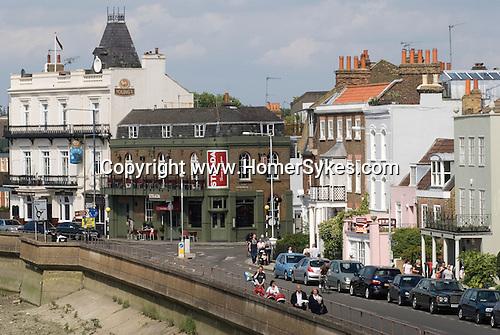 Barnes southwest London Uk. The Terrace road. The welknown jazz venue pub The Bulls Head  on left of image.