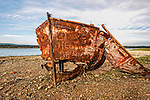 A view of a rusty boat on a beach