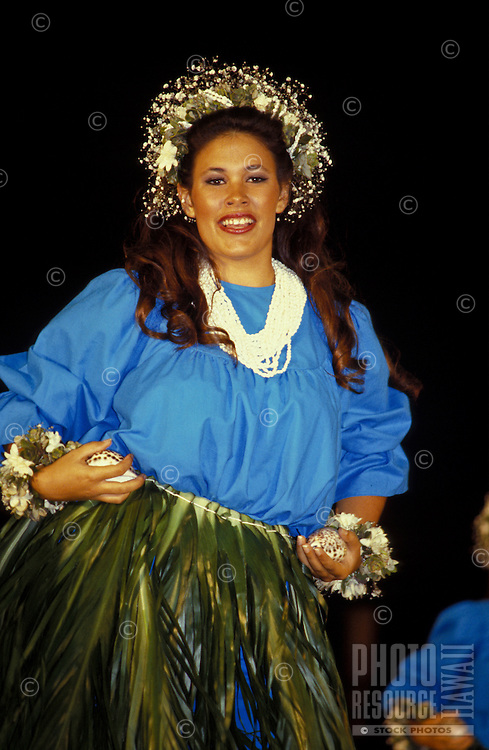 Woman (wahine) dancing Kahiko (modern form) hula at the Merrie Monarch festival on the Big Island