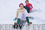 Sleighing : Sisters Ciara & Keelin Galvin , Mountcoal, Listowel sleighing down their driveway on Sunday last.