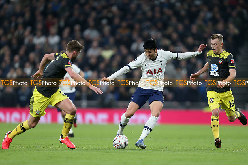 Son Heung-Min of Tottenham Hotspur and James Ward-Prowse and Jack Stephens of Southampton during Tottenham Hotspur vs Southampton, Emirates FA Cup Football at Tottenham Hotspur Stadium on 5th February 2020