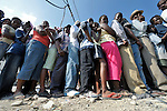 Earthquake survivors in the quake-ravaged Haitian city of Leogane line up to receive emergency supplies provided by Caritas Internationalis and Diakonie, a member of the ACT Alliance, on January 20. Hundreds of families in the town are homeless following a January 12 earthquake, and the two church-sponsored agencies worked together to bring them help. The aid groups organized an air cargo shipment of 34 tons of relief supplies from Europe, along with basic medicines for 80,000 people. The plane wasn't allowed to land in Port-au-Prince until January 20, yet it was unloaded within hours and aid was shipped immediately to Leogane in United Nations trucks, where under watch by United Nations soldiers from Argentina it was unloaded by residents and quickly distributed.