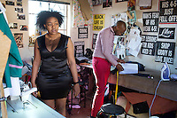 SOWETO, SOUTH AFRICA JULY 3: Lethabo Tsatsinyane, a young designer part of the group Smarteez attends to a customer who came for fittings at his workshop on July 3, 2014 in Jabulani section of Soweto, South Africa. Soweto today is a mix of old housing and newly constructed townhouses. A new hungry black middle-class is growing steadily. Many residents work in Johannesburg but the last years many shopping malls have been built, and people are starting to spend their money in Soweto. (Photo by: Per-Anders Pettersson)