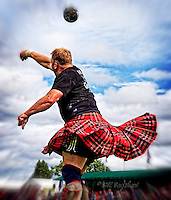 Swirling kilts as The Heavies put the stone at The Aboyne Highland Games,Royal Deeside,Scotland.<br />