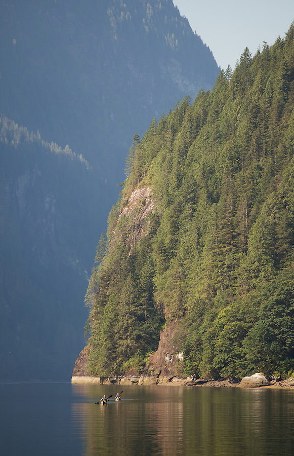 A male and female kayaker are seen at the end of Princess Louisa inlet along the coast of British Columbia.