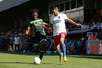 Joan Luque of Dagenham and Redbridge and Peter Kioso of Hartlepool United during Dagenham & Redbridge vs Hartlepool United, Vanarama National League Football at the Chigwell Construction Stadium on 14th September 2019