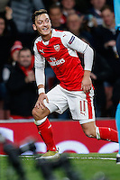 Mesut Ozil of Arsenal celebrates scoring his 2nd goal of the game to make it 5-0 during the UEFA Champions League match between Arsenal and PFC Ludogorets Razgrad at the Emirates Stadium, London, England on 19 October 2016. Photo by David Horn / PRiME Media Images.