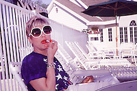 Mom, aka Barbara Knippel, puts on some lipstick after lunch by the pool at the Oneida Country Club in Green Bay on July 4, 2002.