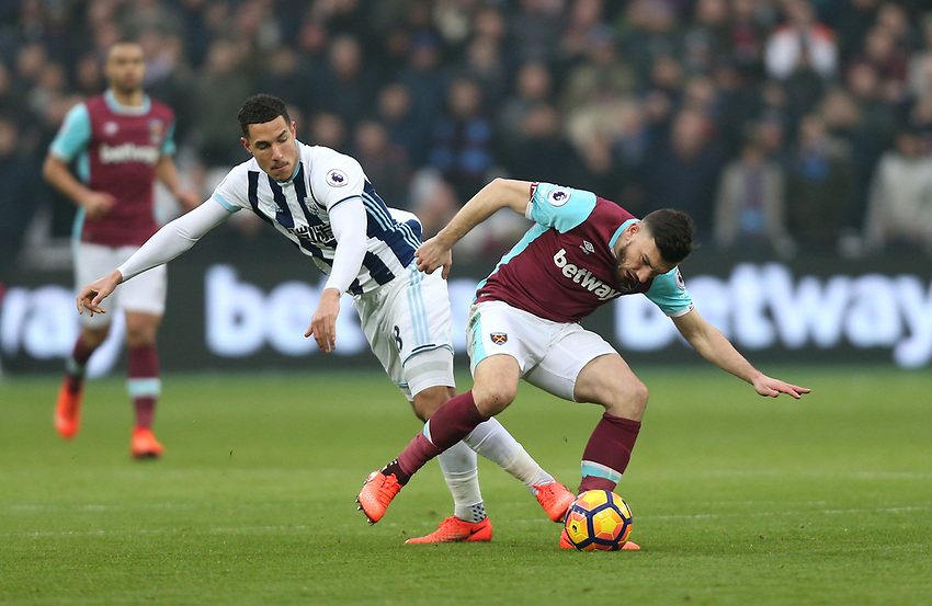 West Bromwich Albion's Jake Livermore and West Ham United's Robert Snodgrass<br /> <br /> Photographer Rob Newell/CameraSport<br /> <br /> The Premier League - West Ham United v West Bromwich Albion - Saturday 11th February 2017 - London Stadium - London<br /> <br /> World Copyright &copy; 2017 CameraSport. All rights reserved. 43 Linden Ave. Countesthorpe. Leicester. England. LE8 5PG - Tel: +44 (0) 116 277 4147 - admin@camerasport.com - www.camerasport.com