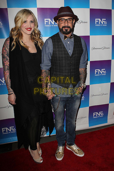 Rochelle Deanna Karidis & AJ McLean.Paramount Studios' 16th Annual Friends 'N' Family Party Held At Paramount Studios, Los Angeles, California,.USA, 8th February 2013..full length black  leggings holding hands couple hat glasses blue shirt jeans waistcoat grey gray tattoos .CAP/ADM/KB.©Kevan Brooks/AdMedia/Capital Pictures.