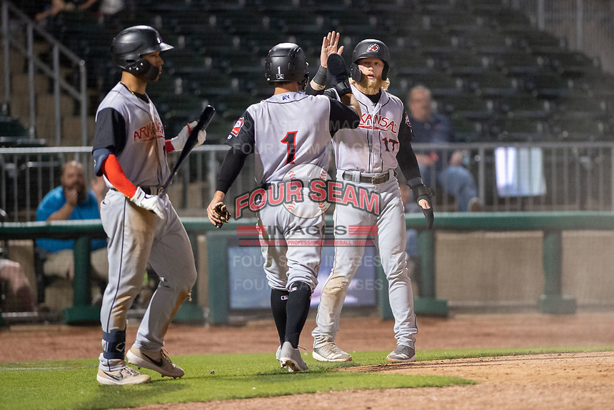 Arkansas Travelers outfielders Aaron Knapp (1) and Jake Fraley (17) congratulate one another after scoring runs during a Texas League game between the Northwest Arkansas Naturals and the Arkansas Travelers on May 30, 2019 at Arvest Ballpark in Springdale, Arkansas. (Jason Ivester/Four Seam Images)