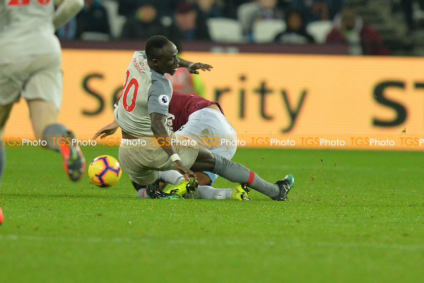Sadio Mane of Liverpool is tackled during West Ham United vs Liverpool, Premier League Football at The London Stadium on 4th February 2019