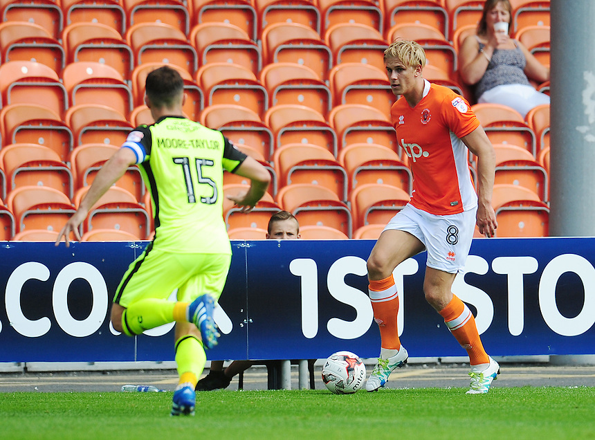 Blackpool's Brad Potts under pressure from Exeter City's Jordan Moore-Taylor<br /> <br /> Photographer Kevin Barnes/CameraSport<br /> <br /> Football - The EFL Sky Bet League Two - Blackpool v Exeter City - Saturday 6th August 2016 - Bloomfield Road - Blackpool<br /> <br /> World Copyright &copy; 2016 CameraSport. All rights reserved. 43 Linden Ave. Countesthorpe. Leicester. England. LE8 5PG - Tel: +44 (0) 116 277 4147 - admin@camerasport.com - www.camerasport.com
