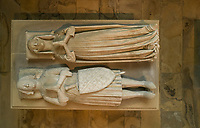 Effigies from the tomb of Marguerite d'Artois, d. 1311, wife of Louis de France, daughter of Philippe d'Artois, wearing a chin guard, and Louis de France, 1275-1319, count of Evreux, son of Philippe III the Bold, seen from above, in the Basilique Saint-Denis, Paris, France. Both were commissioned in the early 14th century for the Eglise des Jacobins in Paris and moved to Saint-Denis in 1817. The basilica is a large medieval 12th century Gothic abbey church and burial site of French kings from 10th - 18th centuries. Picture by Manuel Cohen