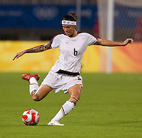 USWNT forward Natasha Kai passes the ball forward while playing at Shanghai Stadium.  The US defeated Canada, 2-1, in extra time and advanced to the semifinals during the 2008 Beijing Olympics in Shanghai, China.