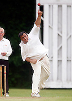 Syed Karrar bowls for Highgate during the Middlesex County Cricket League Division Three game between Highgate and Hornsey at Park Road, Crouch End, London on Sat June 5, 2010