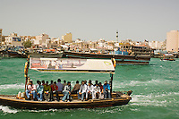 United Arab Emirates, Dubai, Passengers on Small Boat or Abra crossing Dubai Creek