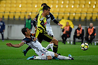 Wellington Phoenix&rsquo; Andrija Kaluderovic and Melbourne Victory&rsquo;s Mark Milligan in action during the A League - Wellington Phoenix v Melbourne Victory FC at Westpac Stadium, Wellington, New Zealand on Wednesday 10 January 2018. <br /> Photo by Masanori Udagawa. <br /> www.photowellington.photoshelter.com